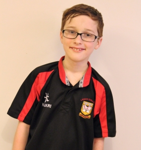 Declan in his Lagan College football kit.