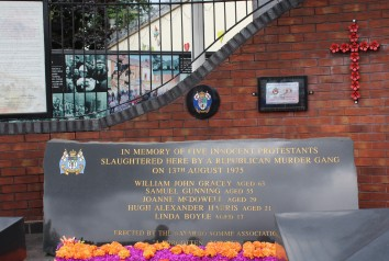 Memorials to those killed during the Troubles appear on both sides of the divide.