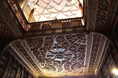 The ceilings and mouldings are ornate.