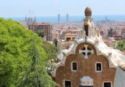 View of the Porters Lodge at Park Güell, with Antoni Gaudí's masterpiece La Sagrada Família at upper left (under the cranes).