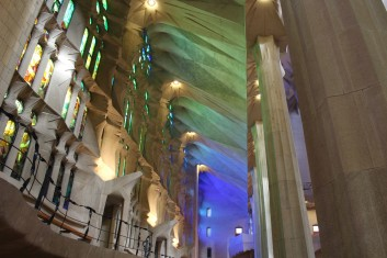 Colors from the windows wash through the basilica.